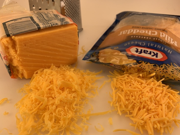 comparing product shelf life on block or shredded cheese